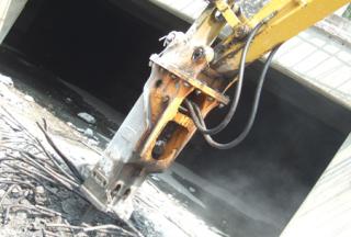 TECHNOLOGY Hydraulic Hammer vs. Steel Reinforced Concrete